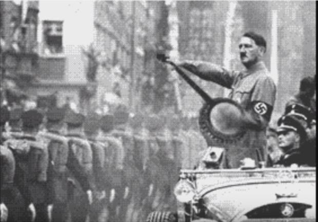 """Kuva 11. Hitler-huumoria YouTubessa. """"Rappio""""-videossa Hitler soittaa banjoa ja moshaa kuin viimeistä päivää. Lähde:"""