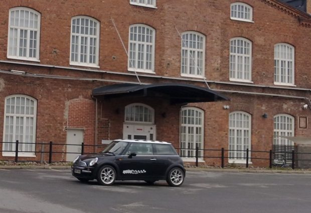 Image 6. A new Mini in the car park of Pori Cotton. The former factory building on the background is a health center nowadays. Photo by Jaakko Suominen, 18 May 2012.